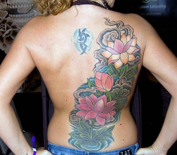 Back tattoo a flower ink design makes a girl look attractive