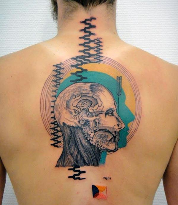 Back Tattoo with a man face design make a man look gallant