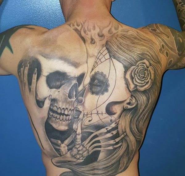 Back Tattoo with a black ink design brings the astonishing look
