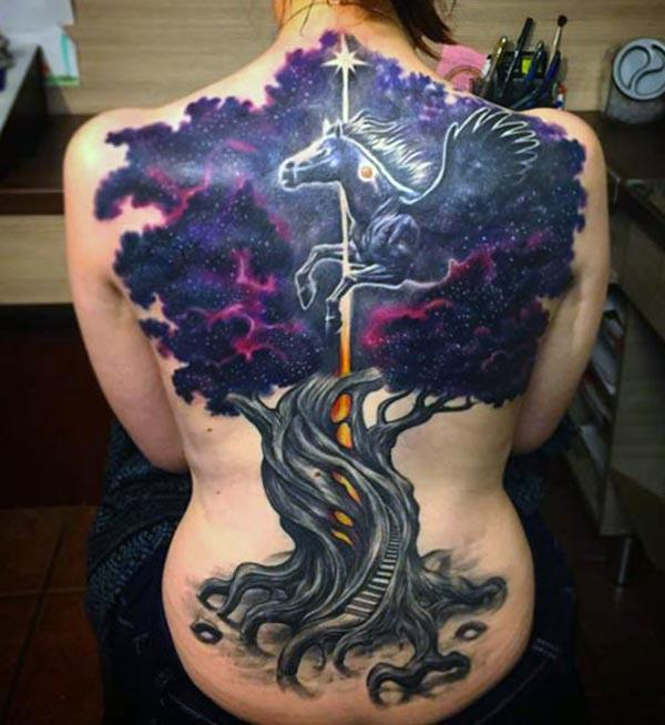 Back Tattoo with a purple tree ink design makes a women look attractive