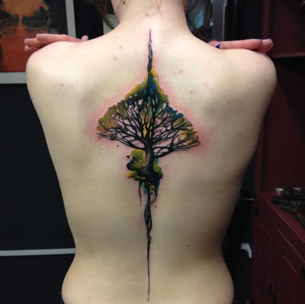 Back Tattoo with a tree design makes a woman look captivating