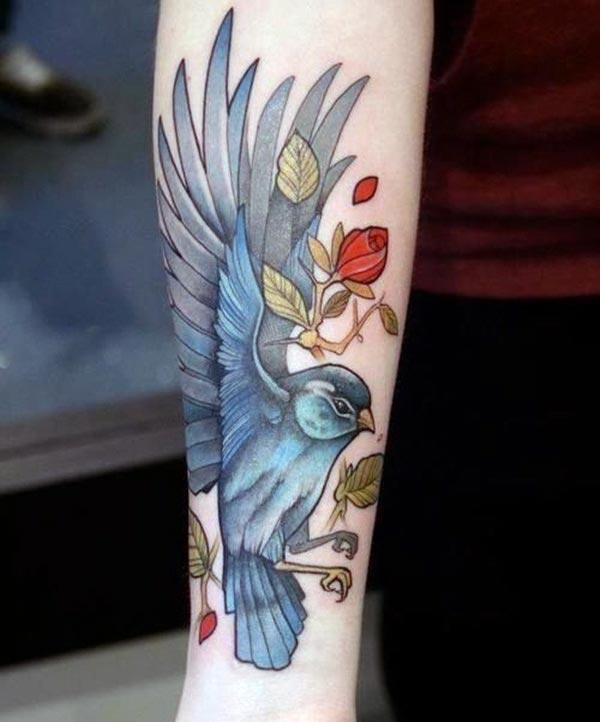 Bird tattoo on the lower arm brings the astonishing look