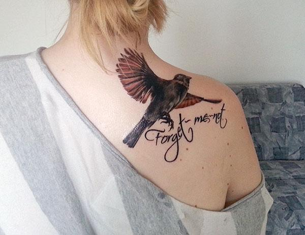 Brown ink design of the bird tattoo on the back shoulder of ladies make them look attractive