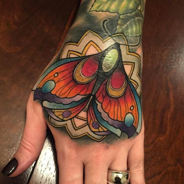 Butterfly tattoo on a girl hand make her look attractive