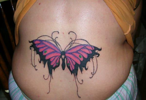Butterfly tattoo on the back abdomen make a lady look captivating