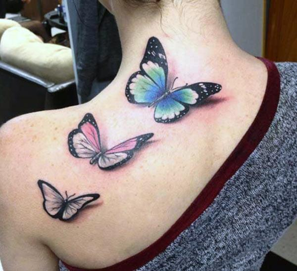 Butterfly tattoo at the back make a girl look astonishing