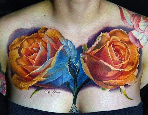 Chest tattoo with an orange flower design makes a women look attractive