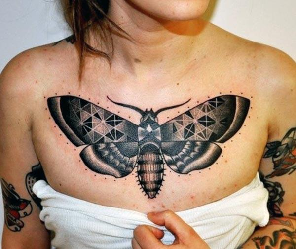 Chest tattoo in ladies with a black ink design, brings out their gorgeous look