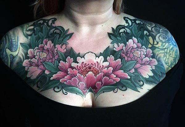 Pink and green ink design of the Chest tattoo make ladies look attractive