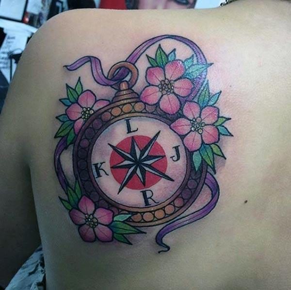 Compass tattoo for Women with a flower design make them look exquisite