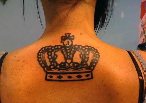 The dark design in of the Crown tattoo, on the back neck to make girls have splendid look