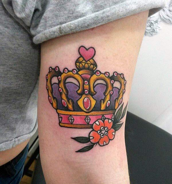 Crown tattoo on the lower arm makes a woman look captivating