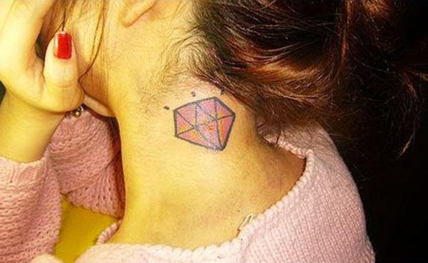 The pink, ink mix design diamond tattoo on the side of the neck make girls attractive