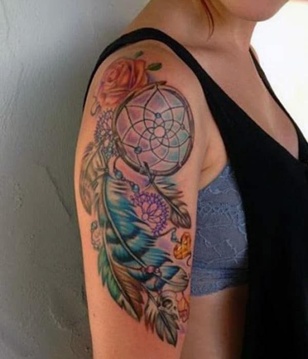 Purple and blue ink design of the Dreamcatcher tattoo on the shoulder of girls make them look attractive