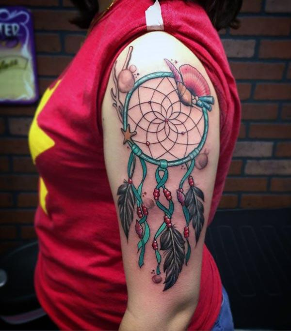 Dreamcatcher tattoo with a brown ink design make them look alluring