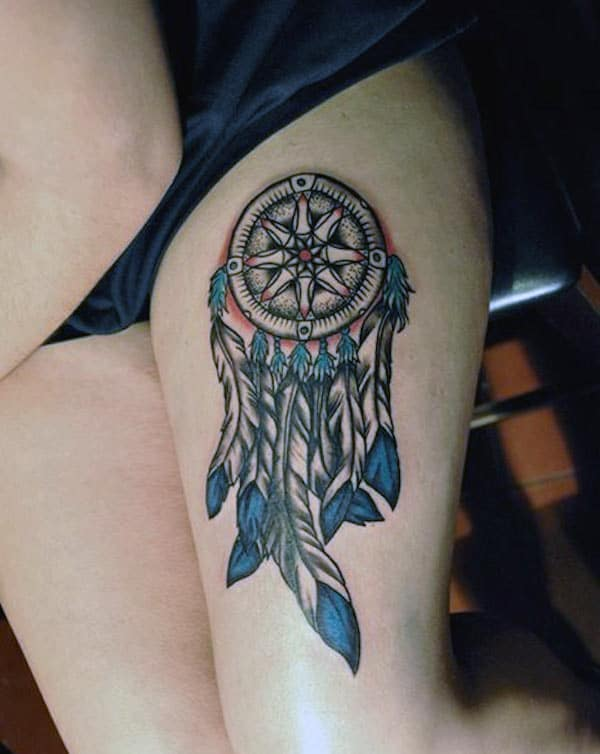 Dreamcatcher tattoo on the side thigh makes a woman look captivating