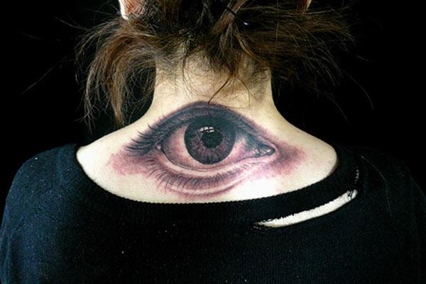 Eye tattoo with black and pink ink design make them look lovely.