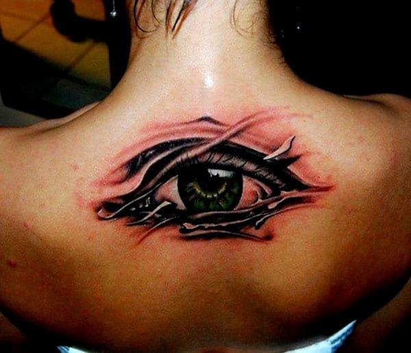 Eye tattoo on the back makes a women look attractive