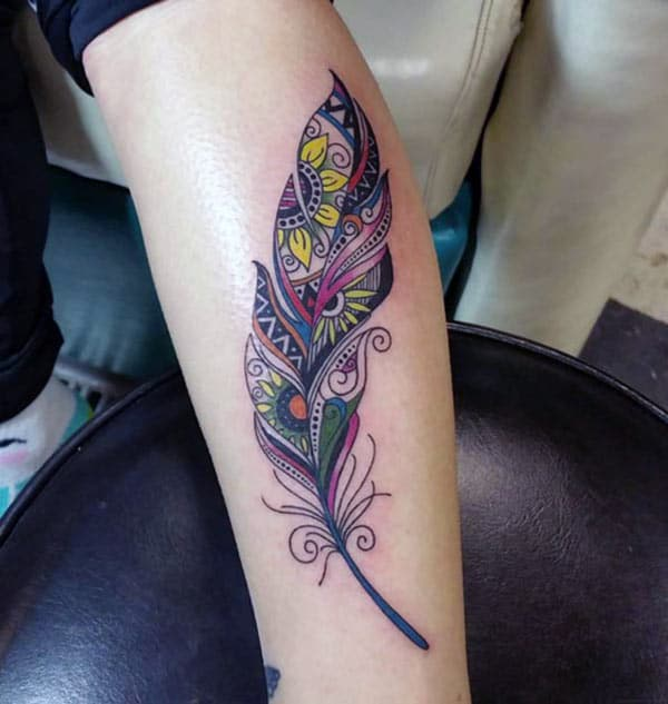 Feather tattoo on the upper arm make them look splendid