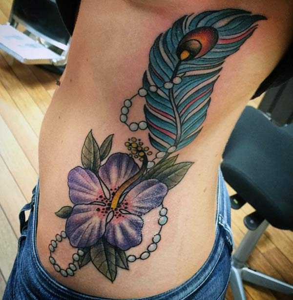 Feather tattoo with a purple ink flower design makes girls to appear gorgeous