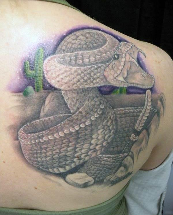 Snake tattoo on the shoulder makes a girl alluring