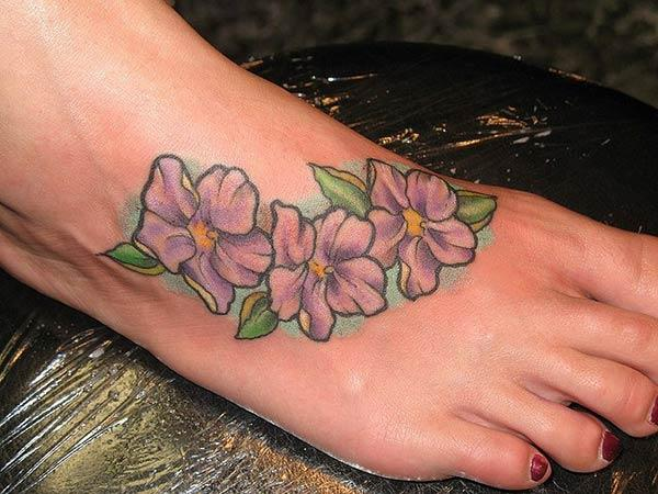 Flower tattoo with a purple ink design makes a girl alluring