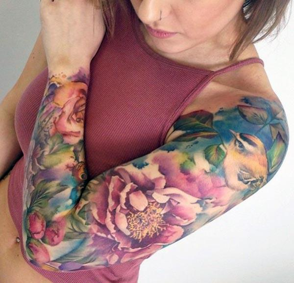 Tattoo of flowers with pink designs and yellow ink make a girl look stylish