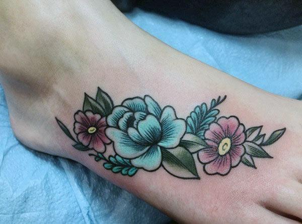 Foot tattoo on the leg with flower design make a girl look elegant