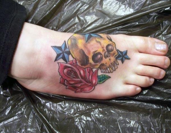 This bright foot tattoo with skull design make girls look more charismatic