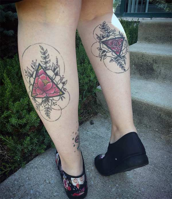 Geometric tattoo with a black ink design flower make them look attractive