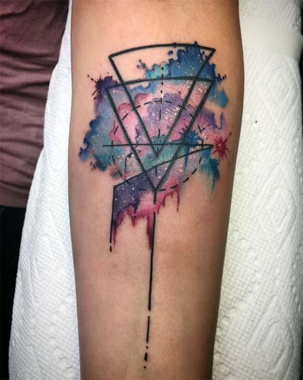 Geometric tattoo on the arm makes a man look gallant