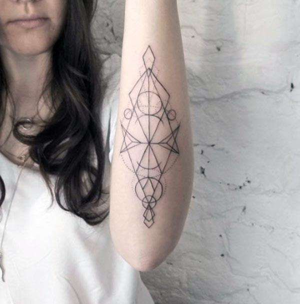 Geometric tattoo for Women with a black ink design; makes them look charming