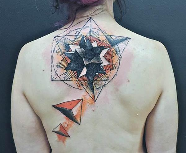 Purple ink design of the Geometric tattoo on the back of ladies make them look attractive