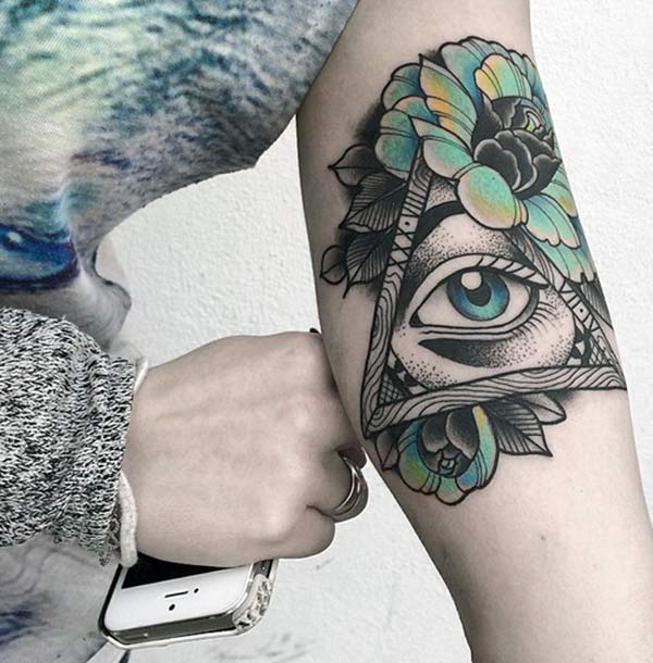 Geometric tattoo on the upper arm gives the captive look in girls