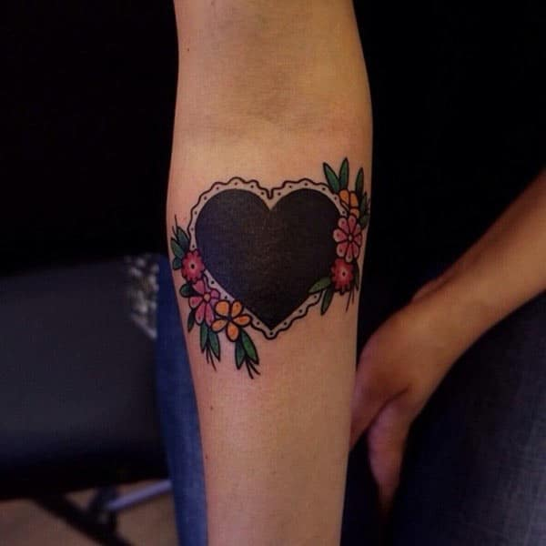 Heart Tattoo with a black ink design make woman look decorative