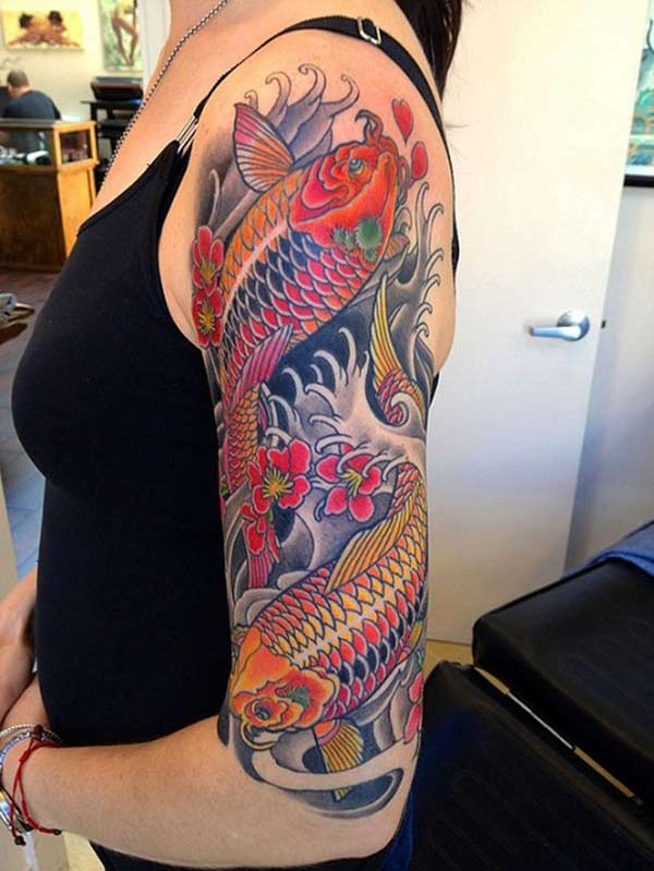 Koi Fish Tattoo for Women on the arm makes them look graceful