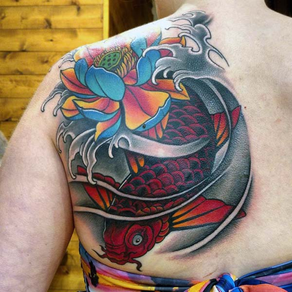 Koi Fish Tattoo for Women with a red ink design on the back makes them look decorative