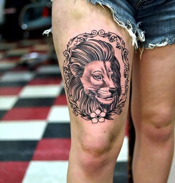 Lion Tattoo for Women with a black ink design make them look captivating