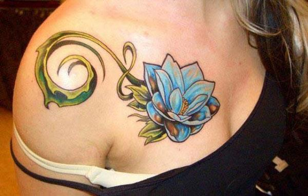 Lotus Flower tattoo on the upper chest make a girl look elegant