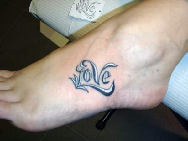 Love tattoo with a black ink design make them look attractive