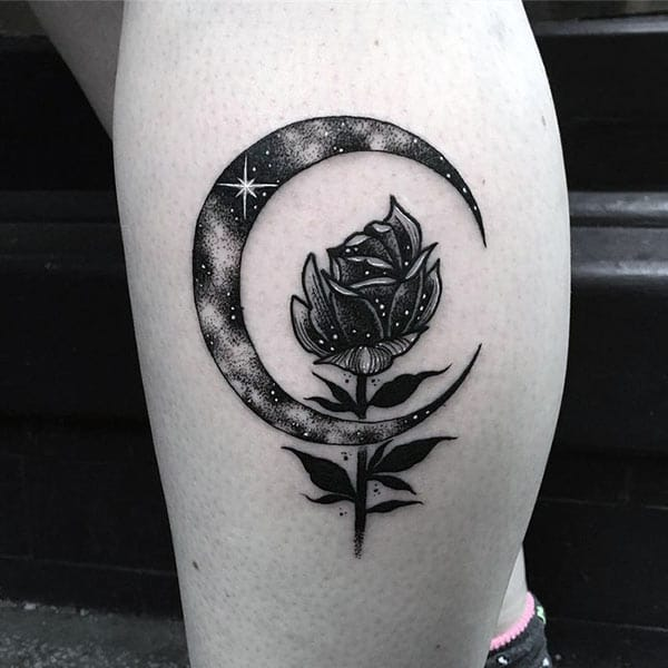 Moon tattoo with a black ink design make a girl look classy