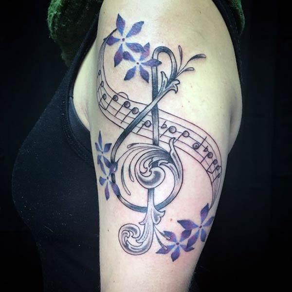 Music Tattoo for Women with black ink design make them look attractive