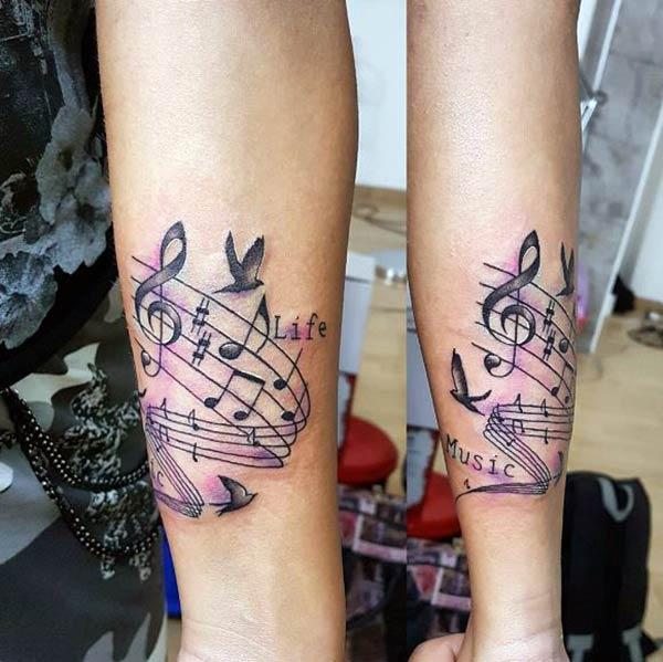 The Music Tattoo with a dark ink design make a girl look admirable