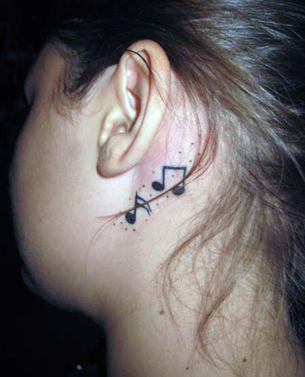 Music Tattoo behind the ear brings the feminist look