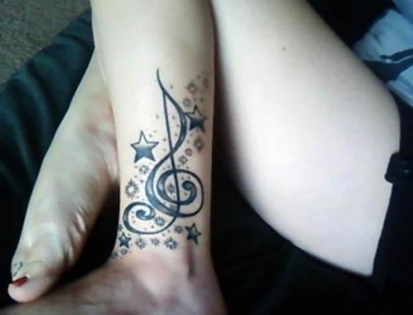 Music Tattoo with a black ink design make a girl look stylish