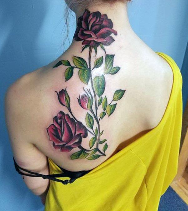 The Rose Tattoo with a pink design ink on a brown skin make a girl look captivating