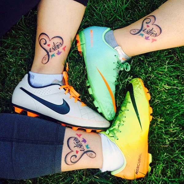 The dark design ink of the Sister Tattoo on the foot matches the skin color, give sisters' dapper look