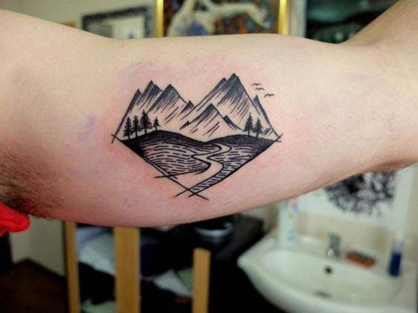 Bicep Tattoo for men with black hill ink design makes a man look classy