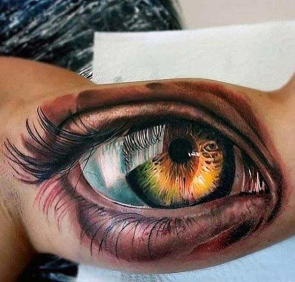 Bicep tattoo with an eye ink design makes a man alluring