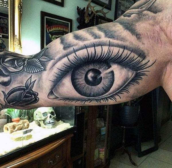 Bicep Tattoo for men with a black design ink of an eye make them look attractive